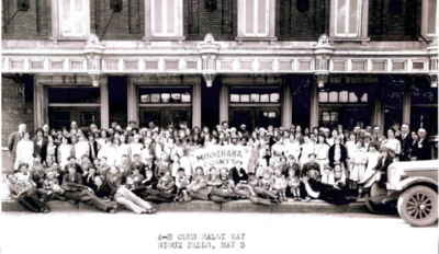Members of the Minnehaha County 4-H club group photo in front of a building. May 3, 1930 Sioux Falls, SD