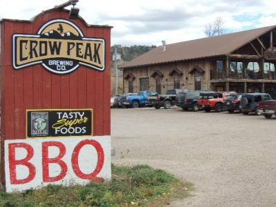 A large enterance sign at the Crow Peak Brewery.