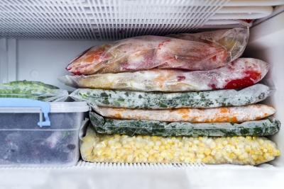 various meals packed in ziplock bags and stored in a freezer