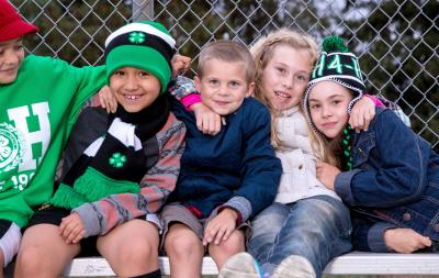 a group of young children wearing 4-H clothing