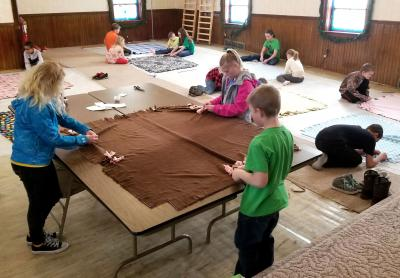 group of 4-H youth participating in a blanket-making workshop