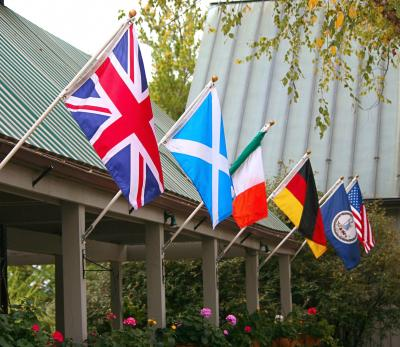 various international flags displayed at an outdoor pavilion