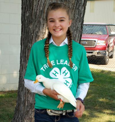 female 4-H youth holding a white duck