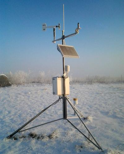 A South Dakota Mesonet station in a snow-covered field.