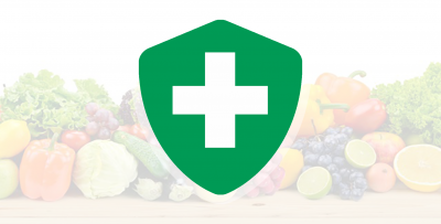 A green shield icon with a white cross in front of a variety of fruits and vegetables.