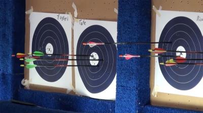 4-H archery targets with arrows in them.