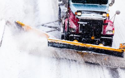 snow plow clearing a highway