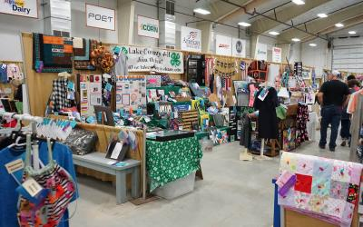 4-H exhibits displayed in a large room