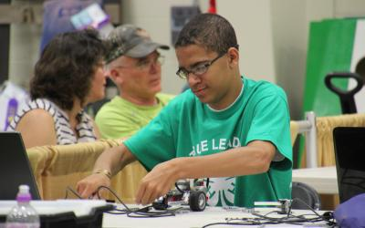4-H member working on a robotics project