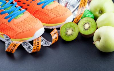 orange tennis shoes with fruit and a measuring tape