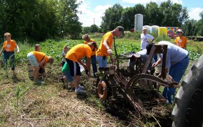 community members working in a local garden plot