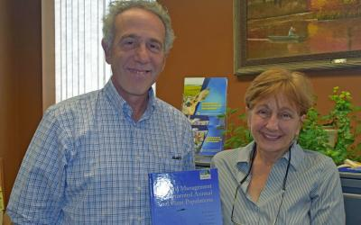 holding their book, SDSU Professors Dr. Charles Fenster, left and Dr. Michele Dudash