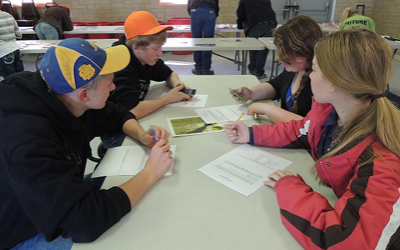 Group of teens filling out worksheet, 4-H, Livestock Skill-a-thon