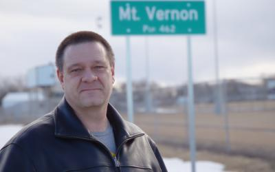 David Anderson standing in front of the Mt. Vernon sign.