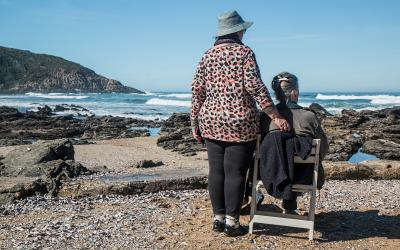 Two older women on a beach.