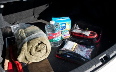 Winter emergency kit in trunk of car.