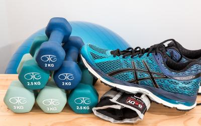 athletic shoe next to stack of small weights