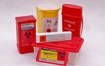 FDA-approved sharps disposal containers.