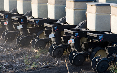 Soybean seed drill planting soybeans. Courtesy: Soybean Checkoff [CC BY 2.0].