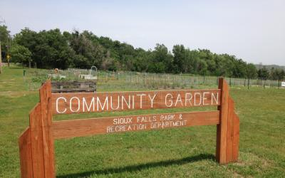 a wooden sign for a community garden