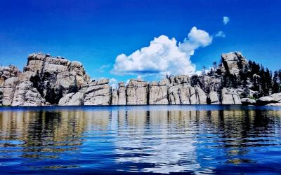 granite rock formation surrounding a lake.