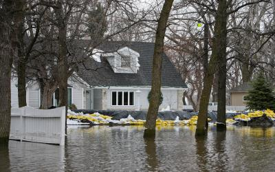 Sand Bagged home in surrounded by flood water. FEMA News Photo