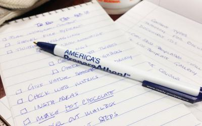 a business checklist written on a pad with a pen. Photo by Eilis Maynard, FEMA