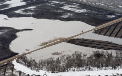 crop fields flooded by spring snow melt. USDA Photo by Lance Cheung