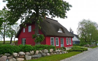a red, cottage-style house