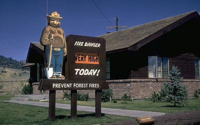 "sign outside park office with fire danger level listed as ""very high"""