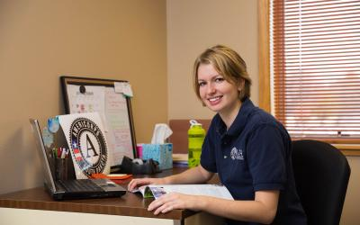 Female volunteer smiling at her desk