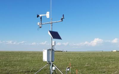 an image of outdoor weather monitoring equipment in a field