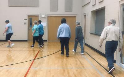 Participants walking  in one of the Physical Activity Evidence-Based programs offered through SDSU Extension