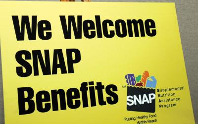 "Sign at a farmers market reading ""we welcome SNAP benefits"""