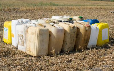 A collection of empty pesticide and herbicide containers.
