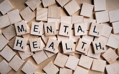 scrabble tiles arranged to spell mental health