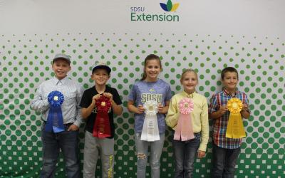 2019 Beginner Livestock Skill-A-Thon Top-5 Individuals holding their awards.
