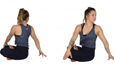 A young woman demonstrating the starting and finishing position for the seated twist yoga pose. For a complete description of the movements, call SDSU Extension at 605-688-6729.