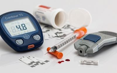 Assorted medical equipment for at-home diabetes testing and care.