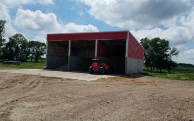 a red shed with grain stored inside