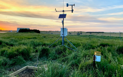 several pieces of weather monitoring equipment in a green field