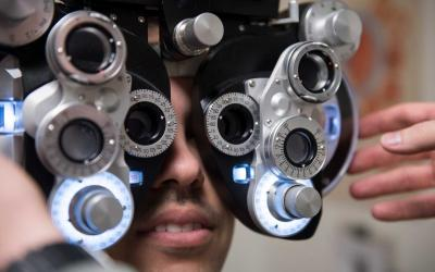 A young man receiving an optometry examination.