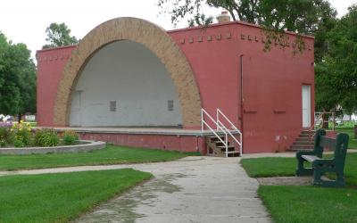A bandshell in a small community park.