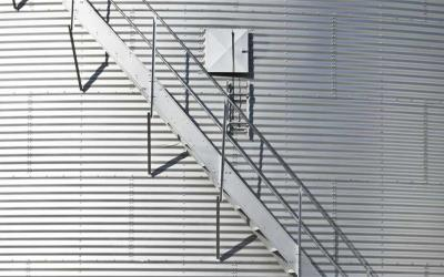 Modern grain bin exterior with built-in staircase.