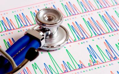 Stethoscope atop a gentic sequencing report.