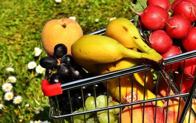 a shopping cart filled with fruits