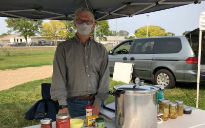 Tim Schreiner at his food preservation booth at the Vermillion Area Farmers Market.